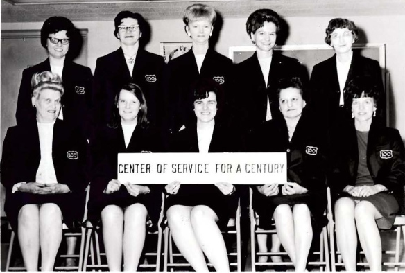 In this undated photo from Kathy's early career, a group of female bank employees are pictured in their skirts and bank jackets. Kathy is pictured in the front row, second from left.