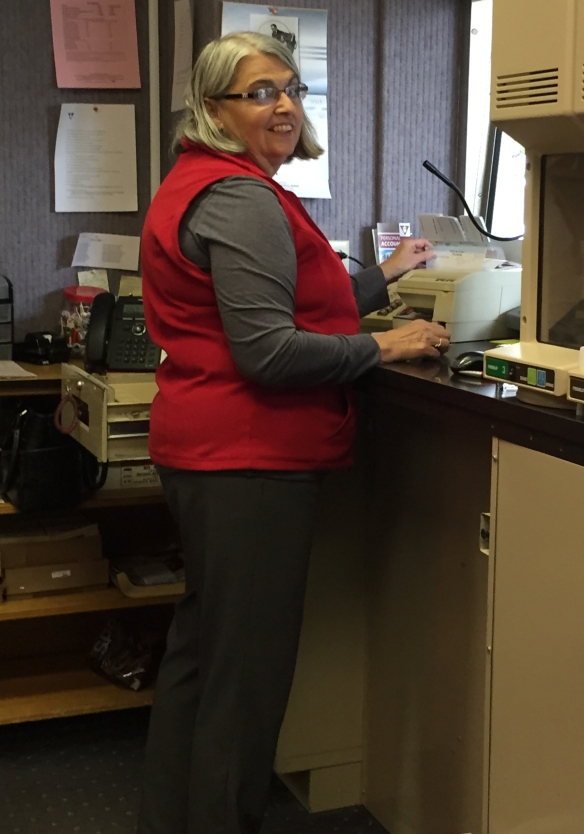 Teller Marti Gray works hard to provide excellent customer service in the drive-thru.