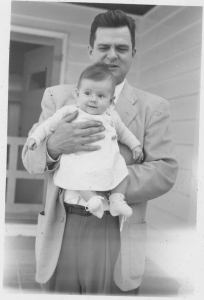 Christyne Calvin is shown with her dad J.G. Will when Christyne was still just an adorable infant. Both Christyne and her father had successful careers with Vinton County National Bank.