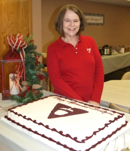 Christyne Calvin poses during her retirement party last week. She will retire this month after 34 years with the bank.