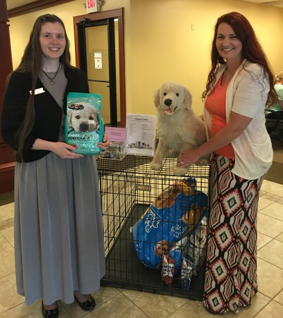 Humane Society Grace and Julie with donations 2016