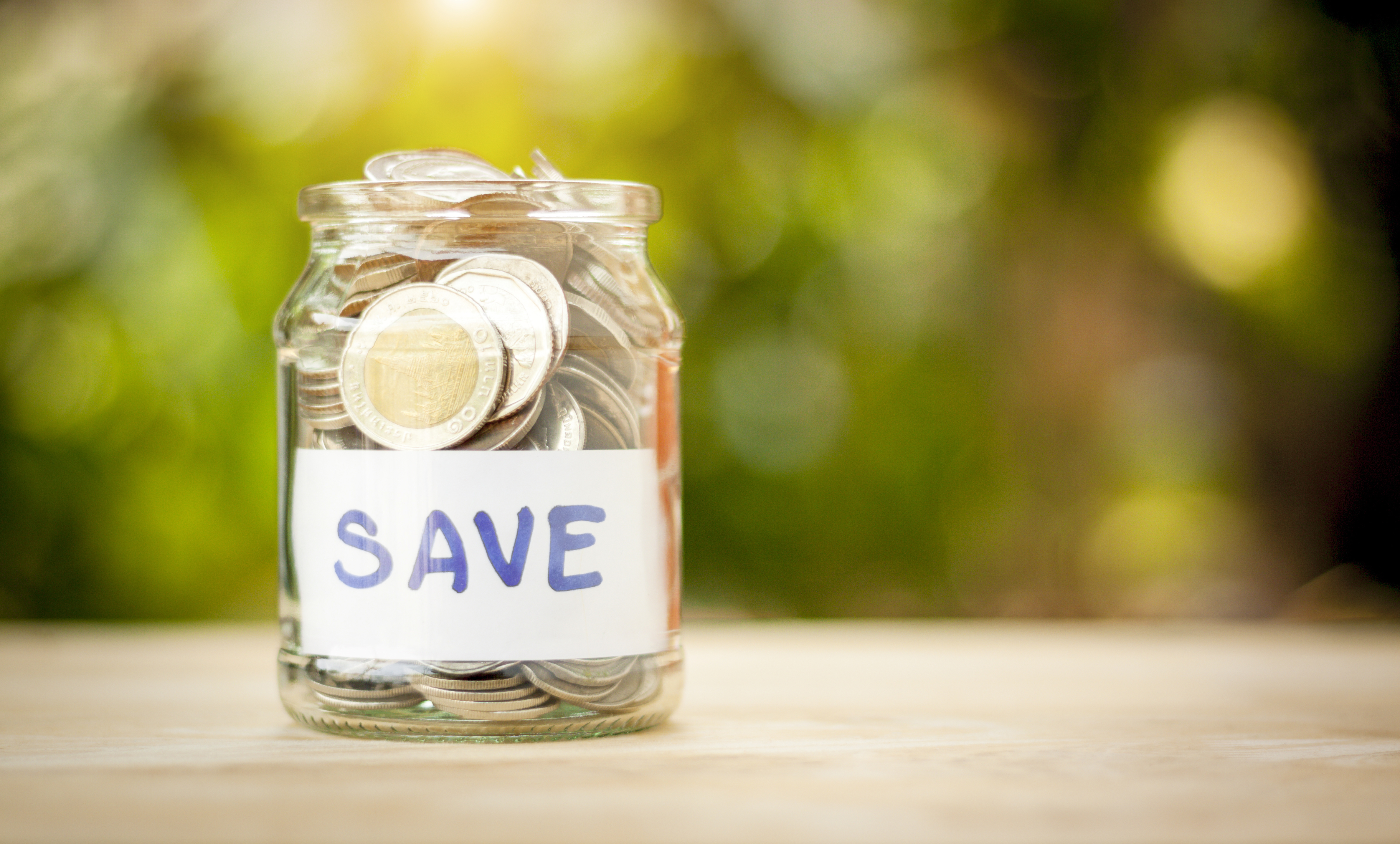 Full coins in a jar. Saving money. Growing concept.Save money for children and future.